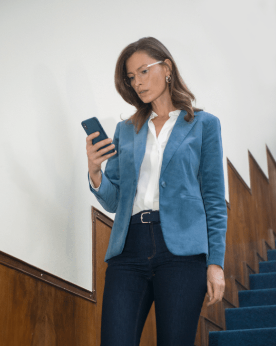 Women with glasses and phone